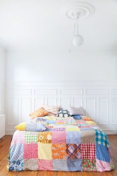 patchwork bedding - looks lika vintage fabric was used