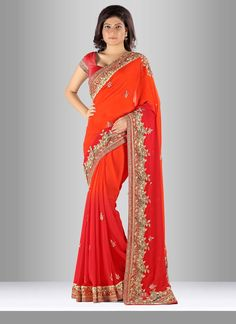 Add a adolescent burst of color for the wardrobe with this pure georgette designer saree. The charming kasab work, kundan work, moti work and silk border patch work a vital element of this attire. Com...