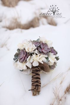Beautifully colored succulents in burlap bouquet