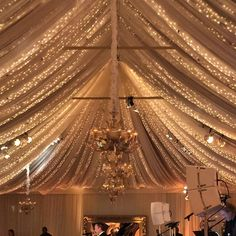Tent twinkles this time underneath light layer of chiffon #revelryeventdesign #mindyweiss