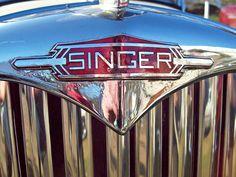 329 Singer Badge.