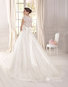 Wide tulle gown. Embroidered lace applications on body and skirt. Crew-neck, transparent lace on back and on yoke. Veil VE1017ColorsOff White