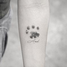 Dotwork paw print tattoo by Sanghyuk Ko