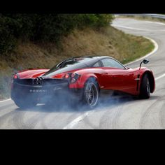 Devil red Pagani Huayra drifting. POW!