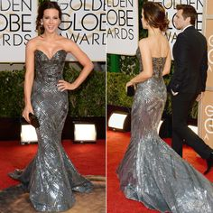 KATE BECKINSALE in a sleekly sculptural Zuhair Murad couture gown that had a sweetheart neckline and flared right out under the knee. The gown felt both bombshell and style-bot, but one thing was for sure: it was hard to take your eyes off her! For an extra spot of sparkle, Kate wore black and white Chopard diamond earrings set in white gold. Her Edie Parker box clutch in a polished black added a final bit of shine. And Jimmy Choo sandals. | 71st Golden Globe Awards | January 12, 2014