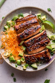 This glazed hoisin and sesame salmon bowl is a delicious low-carb meal idea, served on a bed of cauliflower rice. #Salmon #Cauliflower #Healthy