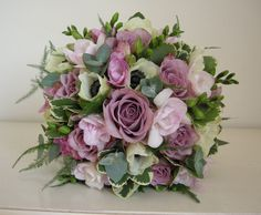 Our team of wedding floral specialists thrive on coming up with new and innovative ideas for artistic bridal flowers, wedding venue designs and wedding flower.