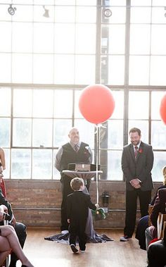 Kelsey and Dave held their ceremony in the atrium at the Ravenswood Event Center. The room was filled with beautiful, warm sunlight and the couple accented the room with big, red balloons! Their ring bearer was even lucky enough to walk down the aisle with a big red balloon of his own.