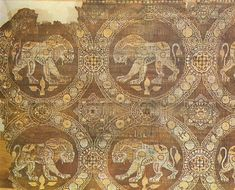 9th - 10th Century AD: Lions. Purple silk serge. From the tomb of St. Julian in Rimini. Byzantine. Museo Naziosle, Ravenna, Spain.