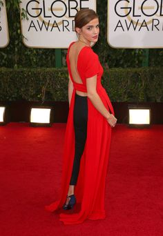 Emma Watson stunned at the 71st annual Golden Globe Awards in her bright red Christian Dior dress.