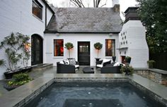 White brick with black trim, outdoor fireplace
