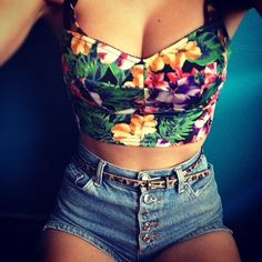 Floral bustier and high waisted shorts. I would put a loose tank over it.