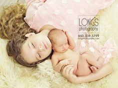 Tallahassee baby and family photographer, Linda Long of Long's Photography, creates gorgeous sibling images with newborn and older sibling, on classic traditional white fur, with sleeping baby snuggled into her sister