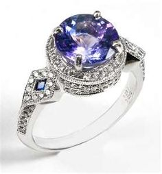 Ladies its not a must your engagement ring to be a diamond ring, it can be a tanzanite. the exquisite Tanzanite ring by Mark Schneider . Tanzanite Jewelry, Gemstone Jewelry, Jewelry Rings, Jewelry Accessories, Fine Jewelry, Tanzanite Gemstone, Love Ring, Sapphire Diamond, Earring Set