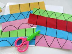 Draw different types of lines on paper and let your child practice cutting.