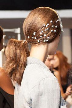 Catwalk ponytail with star detailing #red #hair #ponytail #fashion