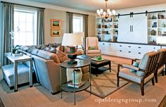 Love this family room from my friends at Opal design. Love love that wall unit and how the tv is hidden.
