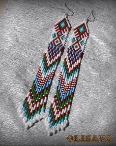 Beautiful beaded dangle peyote earrings with fringe.Native American style, Boho style. Earrings made from Czech beads. Surgical Steel ear wires. Measurements: Length - 17.5 cm (including ear wires) Width - 2.3 cm more earrings here http://www.etsy.com/shop/Olisava?section_id=14128476