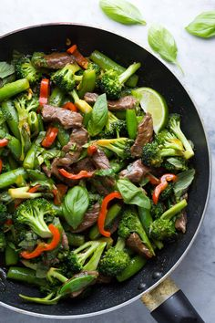 Lime Beef and Basil Stir Fry. This Thai-inspired Lime Beef and Basil Stir Fry is a simple flavorful dish that is on your table in 30 minutes & is packed with veggies! Stir Fry Recipes, Beef Recipes, Cooking Recipes, Healthy Recipes, Recipies, Beef Stir Fry, Easy Dinner Recipes, Dinner Ideas, Easy Recipes