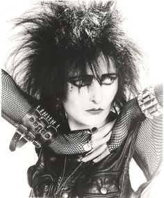 Siouxsie Sioux - loved her look. Had the black back combed hair, shaved down the sides when I was 15/16 - topped off with purple lipstick :)