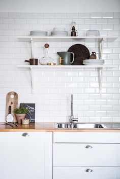 Pastel Colors And Exposed Brick In A Beautiful Stockholm Apartment – The Design Stash Cosy Kitchen, Kitchen Shelf Decor, Kitchen Dining, Kitchen Ideas, Apartment Interior Design, Kitchen Interior, Stand Alone Pantry, Morton Homes, White Wooden Floor