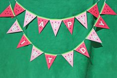 This super, cute happy birthday watermelon banner is perfect for a watermelon birthday party or a summer picnic party. Banner panels are printed on premium cardstock and strung on green ribbon. Each banner pennant is approx. 4 x 5.25inches perfect for a cake table or a back drop.. Assembled banner is approx. 5 feet long if happy birthday is assembled on one line. Banners can also be personalized with a name for an additional $5 (up to 11 letters - contact us for longer names). Name will be…