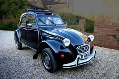 """One of my all-time favorite car designs, the Citroen deux chevaux. All in all, I think it's finer than the Beetle by just a mite. The biggest engine ever installed? Just 29 horsepower on the """"Charleston"""" model, which I believe this one is an example of."""