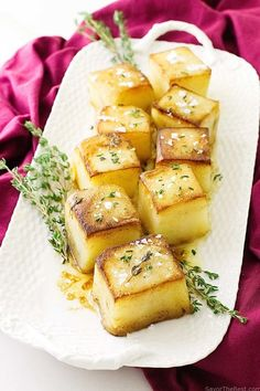 Fondant Potatoes - - Braised Fondant Potatoes have a crusty, golden brown on the top and a smooth creamy interior with the rich flavor of garlic, butter and thyme. This makes a delicious and unique side dish for a special occasion dinner. French Appetizers, Fondant Potatoes, Buttered Cabbage, Pan Fried Salmon, Caramelised Apples, Classic French Dishes, Foundant, Potato Dinner, Little Potatoes