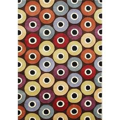 The Circles handmade area rug is constructed from blended New Zealand wool for a soft feel. Contemporary designs, a lush 0.7-inch pile height and a captivating color palette make this rug an ideal accent piece.