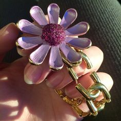 Betsey Johnson-Large Flower Stretch Bracelet Gorgeous and RARE find!This purple/pink-ish stretch bracelet is gorgeous! The links are gold toned and super shiny✨ It is a simple yet beautiful statement piece. Lightly used, only worn twice. Purchased new!The actual stretchy material is a teensy bit stretched out but not old/worn or very noticeable. The gold part of the bracelet is in pristine condition along with the gorgeous flower  Enjoy!☺️ Betsey Johnson Jewelry Bracelets