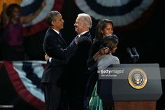 U.S. President Barack Obama and U.S. Vice President Joe Biden embrace on stage with family after his victory speech on election night at McCormick Place November 6, 2012 in Chicago, Illinois. Obama won reelection against Republican candidate, former Massachusetts Governor Mitt Romney.  (Photo by Win McNamee/Getty Images)