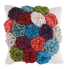 Individually crocheted felted flowers atop a cushion pad.
