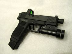 "Glock ""17"" w/ Factory Compettion Threaded barrel, Zev Custom Milled and Serrated Slide, Suppresor Night Sights, Trijicon RMR, BeaverTail Insert, Beveled Magwell, 4.5# Ghost Trigger, Tuned & Polished Internals and Tactical Laser Light Combo ( Alt: Viridian X5L Green Laser Sight with Tac Light). TSG-22LR Conversion Kit."