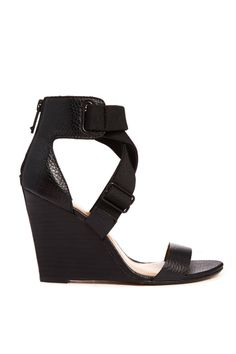 Report Signature Lionna Black Wedge Sandals, $120; reportshoes.com