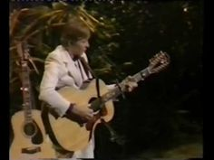 "John Denver ""Bells of Rhymney""             JD does a classic Pete Seeger song about Welsh mining villages.  The lyrics are based on poem by Idris Davies.  As JD explains in the clip, this was his solo song from his Mitchell Trio days.        This performance was from a concert in London in 1982.  SGS"
