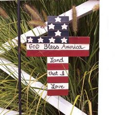 "Stars and Stripes Cross Size: 11 3/4"" x 9 3/8"" Cross shown on a hanger (not included) Red, White Blue with words God Bless American Land that I Love. **Arriving in the next 2 weeks**"