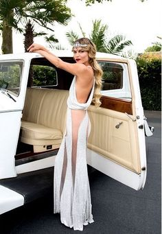 lesliaisonsdemarieantoinette:  LES LIAISONS DE MARIE ANTOINETTE | NATASHA POLY, IN ATELIER VERSACE, ARIVING IN A VINTAGE ROLLS ROYCE FOR HER GATSBY INSPIRED BIRTHDAY BASH. PHOTO, GETTY IMAGES