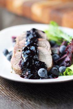 Blueberry Pork Tenderloin with a garlic-herb crust ... and OH the blueberries! Swap stevia or xylitol (to taste) for the sugar.
