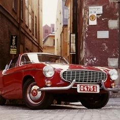 Volvo P1800, little red sports car.