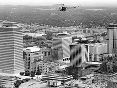 One of three Metro police helicopters flies over downtown