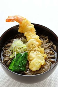"""Toshikoshi Soba, Japanese Buckwheat Noodles Soup with Prawn Tempura, Traditionally Eaten at New Year's Eve Night in Japan