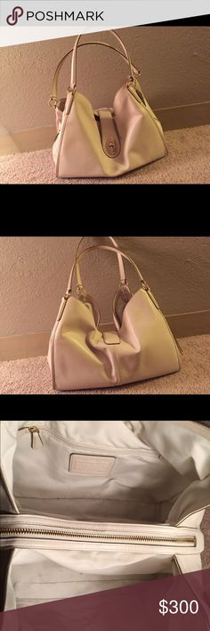 Coach Carlyle bag Brand new white authentic coach Edie bag, worn a few times with a small pen mark on the front and Jean ink that has rubbed of my jeans on the back. Absolutely gorgeous bag. Bought by my self at a coach store. Coach Bags Shoulder Bags