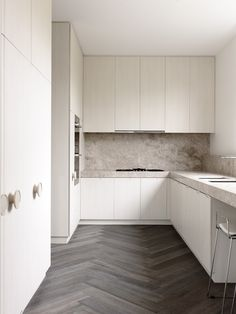 Textural, minimalist kitchen in neutral tones