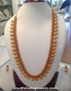 Gold ruby mango long necklace and earrings from New Arun Jewellers. For inquiries please contact 0824 244 Gold Jewellery Design, Gold Jewelry, Diamond Jewellery, Gold Necklaces, Ear Jewelry, Mango Mala Jewellery, Kerala Jewellery, Maharashtrian Jewellery, Temple Jewellery