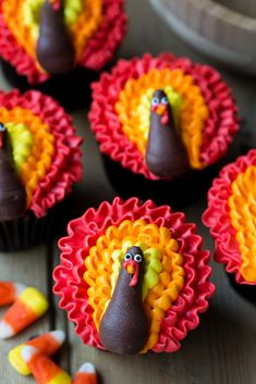 Your fall guests will gobble up these turkey-like cupcakes! Decorating with red, orange, and yellow frosting, and a bit of chocolate creates a fun and festive party treat. Now you're talking turkey! Find more party ideas and tips - bhgrelife.com