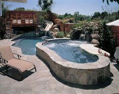 Swim up bar in the pool with a slide and raised deck area. This is definitely my dream pool! Raised Pools, Raised Deck, In Ground Spa, In Ground Pools, Swimming Pool Waterfall, Pool Images, Backyard Pool Landscaping, Dream Pools, Cool Pools