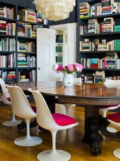 Boldly choose modern tulip chairs to pair with a traditional oak pedestal table in a library style dining room.  For your own custom table our gallery has lots of inspiration: www.custommade.com/gallery/tables/