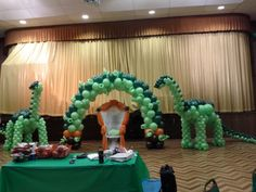 Dinosaur balloon sculpture for baby shower party decoration with balloon arch and wicker chair http: Dinosaur Balloons, Dinosaur Party, Dinosaur Birthday, 3rd Birthday, Baby Boy Decorations, Balloon Decorations Party, Balloon Centerpieces, Fort Lauderdale, Balloon Backdrop