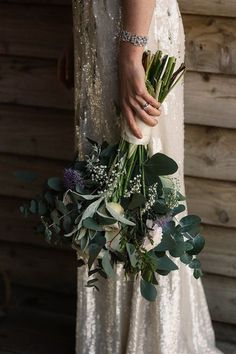 Michelle wore a chic, beaded, Jenny Packham gown for her elegant Sussex barn wedding, and carried a bouquet of green and blue hues. Photography by Paul Joseph. #weddingflowers #bridalbouquet #bouquet #lovemydress #weddingblog