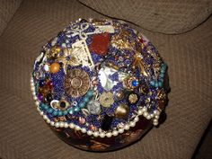 a mosaiced bowling ball using old jewelry and seed beads by diana manning. www.dianamanningstudio.com